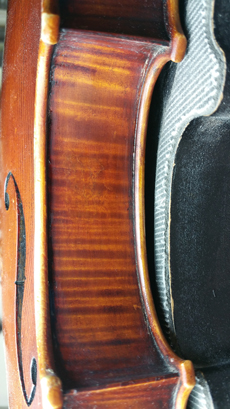 Same violin rib after repair