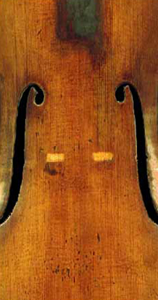 Same violin top after repair; no trace of the cracks remain in the spruce top