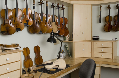 Sapp Violins' repair shop with many violins waiting for repair and tonal adjustments